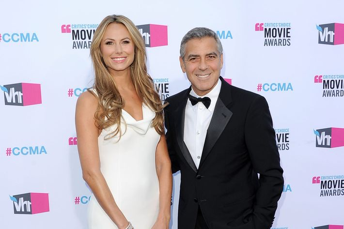Actor/Director George Clooney (R) and actress Stacy Keibler arrive at the 17th Annual Critics' Choice Movie Awards held at The Hollywood Palladium on January 12, 2012 in Los Angeles, California.