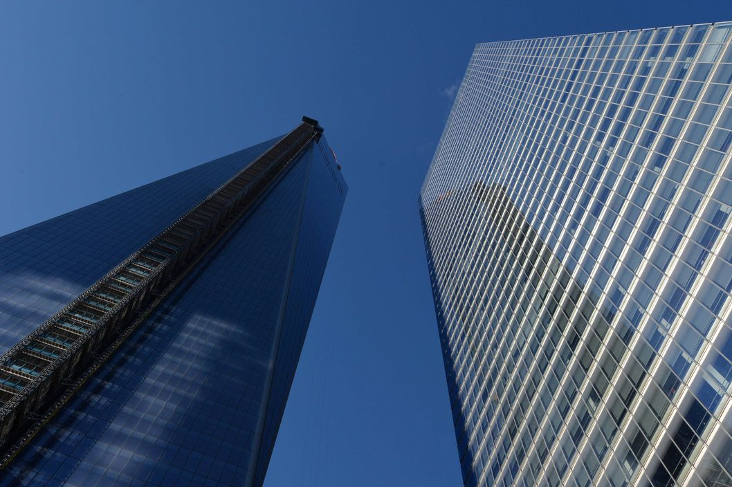 "One World Trade Center, informally called ""Freedom Tower"" (L) still under construction January 29, 2014 in New York next to the Seven World Trade Center (R) building. AFP PHOTO/Stan HONDA        (Photo credit should read STAN HONDA/AFP/Getty Images)"