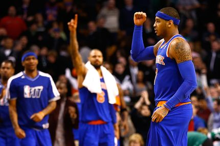 Carmelo Anthony #7 of the New York Knicks reacts after an 89-86 win against the Boston Celtics during the game on January 24, 2013 at TD Garden in Boston, Massachusetts.