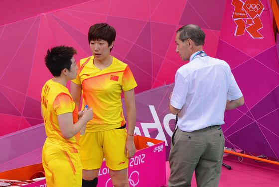 LONDON, ENGLAND - JULY 31:  Wang Xiaoli and Yang Yu of China speak to an official during their match against Ha Na Kim and Kyung Eun Jung of Korea in their Women's Doubles Badminton on Day 4 of the London 2012 Olympic Games at Wembley Arena on July 31, 2012 in London, England.  (Photo by Michael Regan/Getty Images)