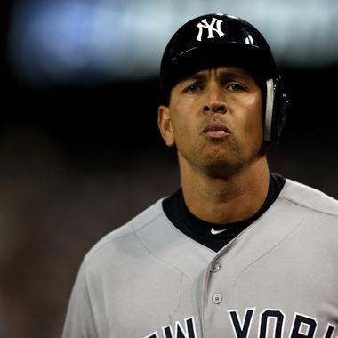 Alex Rodriguez #13 of the New York Yankees walsk off the field back to the dugout after he grounded out in the top of the 9th inning against the Detroit Tigers during game four of the American League Championship Series at Comerica Park on October 18, 2012 in Detroit, Michigan.