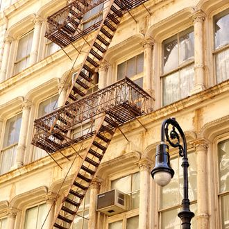 Historic buildings on Greene Street in the SoHo Cast Iron Historic Destrict in New York. This region of New York City has the largest concentration of cast-iron architecture in the world, approximately 250 buildings. The name SoHo is a blend of South and Houston from the geographic location South of Houston Street. The heart of the district is Greene Street, where 50 buildings erected between 1869 nad 1895 are found on 5 cobblestoned blocks. Many of these buildings were built in under four months time because of its simplistic design but used cast iron for decorative purposes which was mass produced but today are rare works of industrial art.