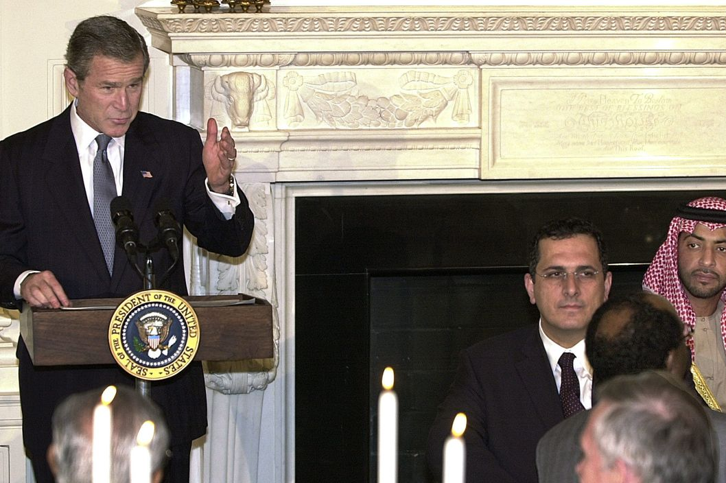 US President George W. Bush (L) addresses an Iftaar dinner 07 November, 2002, at the White House State Dining Room, to celebrate the start of the Islamic holy month of Ramadan. United Arab Emirates Foreign Minister Sheikh Hamdan bin Zayed Al Nahayan (R) and Khaled Saffuri of the Islamic Institute (2nd-R) listened.