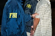 FBI agents escort suspect