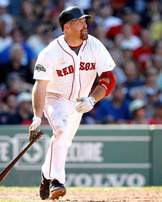 Kevin Youkilis #20 of the Boston Red Sox watches a hit during the interleague game against the Atlanta Braves at Fenway Park on June 23, 2012 in Boston, Massachusetts.