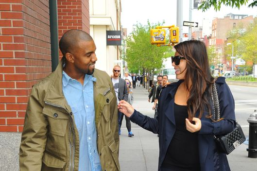 NEW YORK, NY - MAY 06:  Kim Kardashian and Kanye West are seen in Soho on May 6, 2013 in New York City.  (Photo by Raymond Hall/FilmMagic)