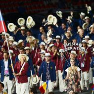Russia's flagbearer Maria Sharapova lead