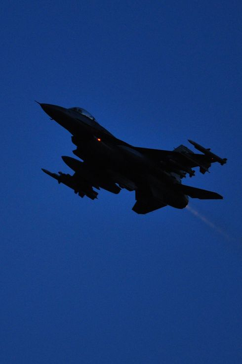 "A US F16 plane takes-off from  the Aviano air base on March 20, 2011. The US, Britain and France pounded Libya with Tomahawk missiles and air strikes into the early hours of today, sparking fury from Libyan leader Moamer Kadhafi who declared the Mediterranean to be a ""battlefield."" AFP PHOTO / GIUSEPPE CACACE (Photo credit should read GIUSEPPE CACACE/AFP/Getty Images)"