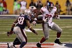 INDIANAPOLIS, IN - FEBRUARY 05:  Running back Brandon Jacobs #27 of the New York Giants runs upfield against the New England Patriots during the first half of Super Bowl XLVI at Lucas Oil Stadium on February 5, 2012 in Indianapolis, Indiana.  (Photo by Win McNamee/Getty Images)