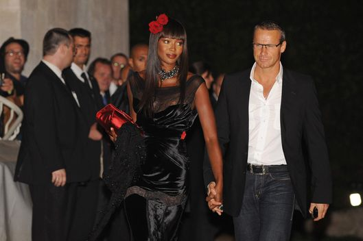 12 Sep 2009, Potsdam, Germany --- British topmodel Naomi Campbell (L) and Vladimir Doronin arrive for the wedding reception of Barbara Becker in Potsdam, Germany, 12 September 2009. Barbara Becker and Arne Quinze got married on 09 September. Photo: JENS KALAENE --- Image by ? Z1008 Jens Kalaene/dpa/Corbis