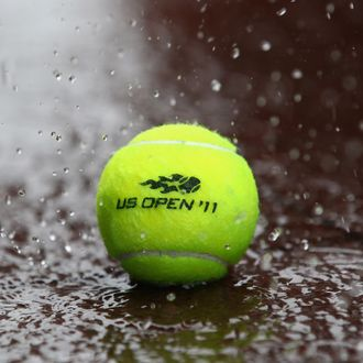 NEW YORK, NY - AUGUST 27: Heavy rain falls on a tennis ball as Hurricane Irene heads up the east coast during previews at USTA Billie Jean King National Tennis Center on August 27, 2011 in New York City. (Photo by Julian Finney/Getty Images)