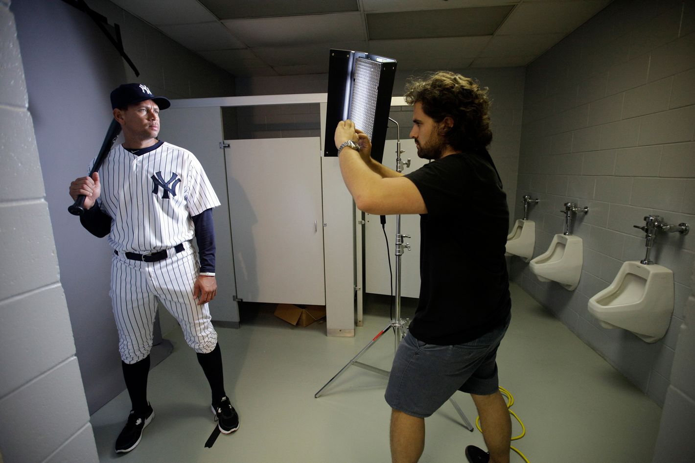 New York Yankees' Alex Rodriguez, left, poses for photographer Nick Laham on photo day