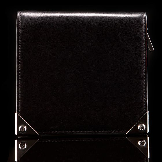 "She'll love the sharp corners on this <b>Alexander Wang wallet</b>.     Alexander Wang Prisma Biker Purse in black with rhodium hardware: $250 at <a href=""http://www.alexanderwang.com/shop/accessories/accessories/small-leather-goods/702008/prisma-compact-with-rhodium-hardware"">alexanderwang.com</a>"