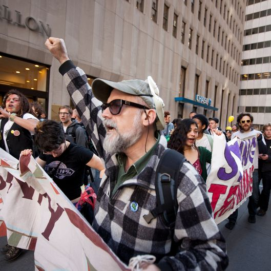 Demonstrators associated with the 'Occupy Wall Street' movement march up Broadway near Wall Street.