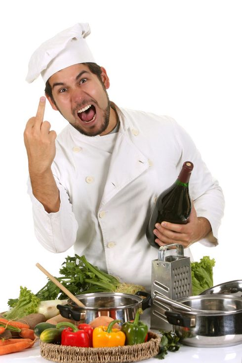 young chef sticking up the middle finger