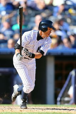 NEW YORK, NY - SEPTEMBER 23:  Ichiro Suzuki #31 of the New York Yankees follows through on a fifth inning base hit against the Oakland Athletics at Yankee Stadium on September 23, 2012  in the Bronx borough of New York City.  (Photo by Jim McIsaac/Getty Images)