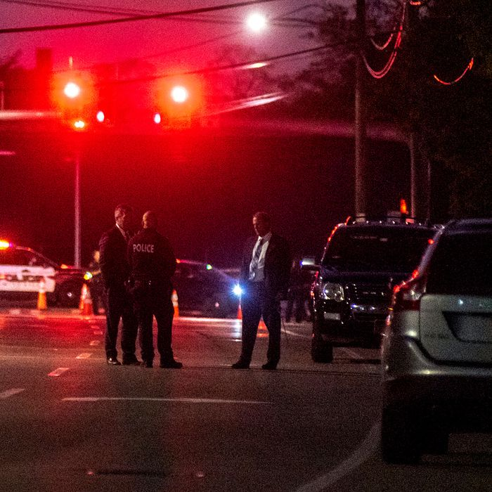 Police officers in Amityville, N.Y., the scene of the fatal stabbing.