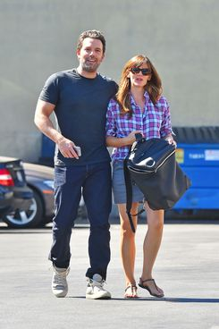 Ben Affleck is affectionate with his wife Jennifer Garner as they walk to lunch together in Brentwood
