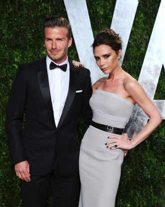 WEST HOLLYWOOD, CA - FEBRUARY 26: Athlete David Beckham (L) and entertainer Victoria Beckham arrives at the 2012 Vanity Fair Oscar Party hosted by Graydon Carter at Sunset Tower on February 26, 2012 in West Hollywood, California. (Photo by Alberto E. Rodriguez/Getty Images)