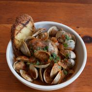 Little neck clams, tomato-orange broth.