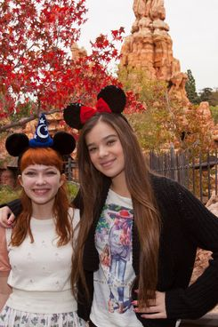 In this handout image provided by Disney Parks, actress Hailee Steinfeld and fashion blogger Tavi Gevinson pose outside Big Thunder Mountain Railroad at Disneyland park on November 10, 2011 in Anaheim, California. (Photo by Paul Hiffmeyer/Disney Parks via Getty Images)