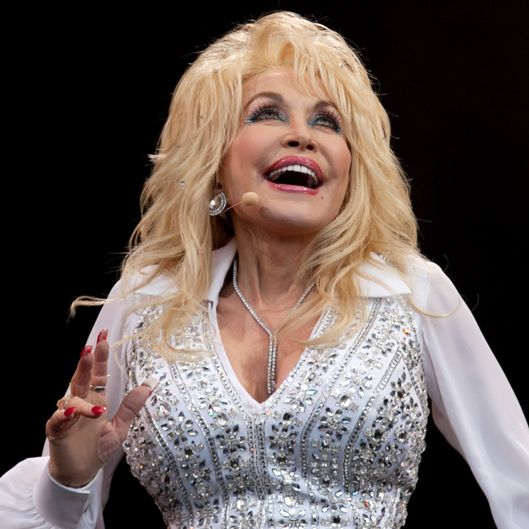 GLASTONBURY, ENGLAND - JUNE 29:  Dolly Parton performs on the main Pyramid Stage at the Glastonbury Festival on June 29, 2014 in Glastonbury, England. Gates opened on Wednesday at the Somerset dairy farm that plays host to one of the largest music festivals in the world. Tickets to the event, which is now in its 44th year, sold out in minutes even before any of the headline acts had been confirmed. The festival, which started in 1970 when several hundred hippies paid ?1, now attracts more than 175,000 people  (Photo by Matt Cardy/Getty Images)