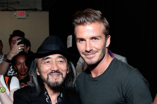 Fashion designer Yohji Yamamoto (L) and professional soccer player David Beckham attend the Y-3 10th Anniversary Collection at St. John's Center on September 9, 2012 in New York City.