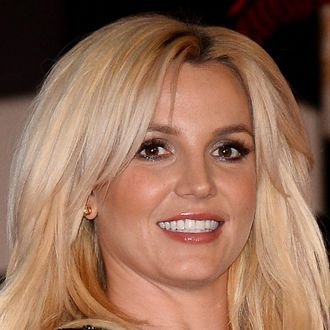 Singer Britney Spears arrives at a welcome ceremony as she celebrates the release of her new album