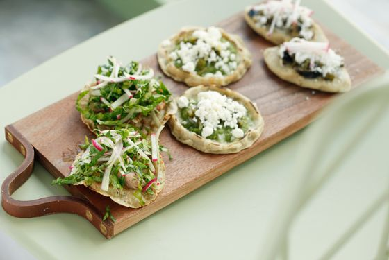 Crunchy tosatas with braised brisket; masa tarts with queso fresco; and fava-bean-filled masa cakes.