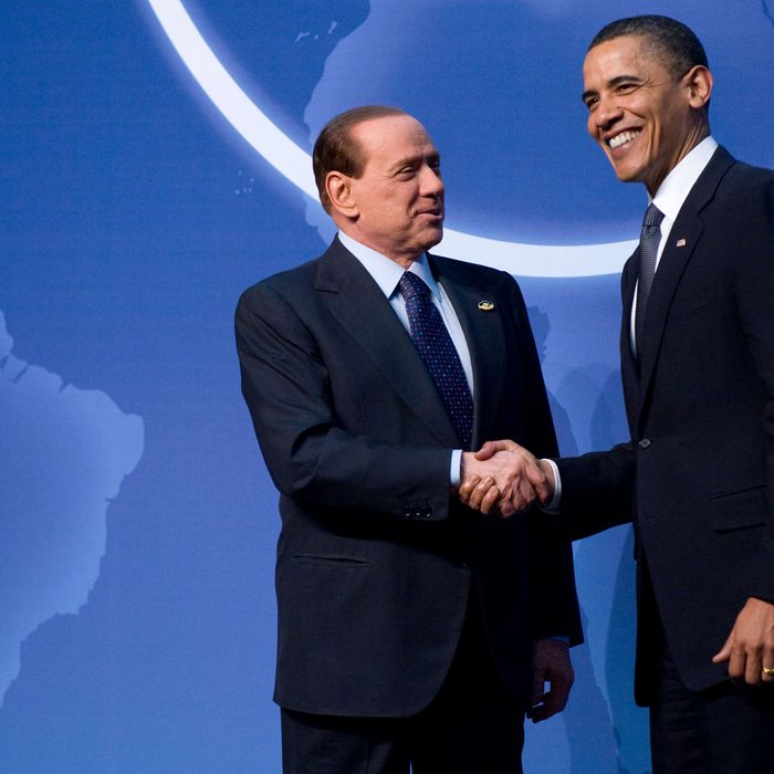 US President Barack Obama (R) greets Italian Prime Minister Silvio Berlusconi upon his arrival for dinner during the Nuclear Security Summit at the Washington Convention Center in Washington, DC, April 12, 2010. AFP PHOTO / Jim WATSON (Photo credit should read JIM WATSON/AFP/Getty Images)