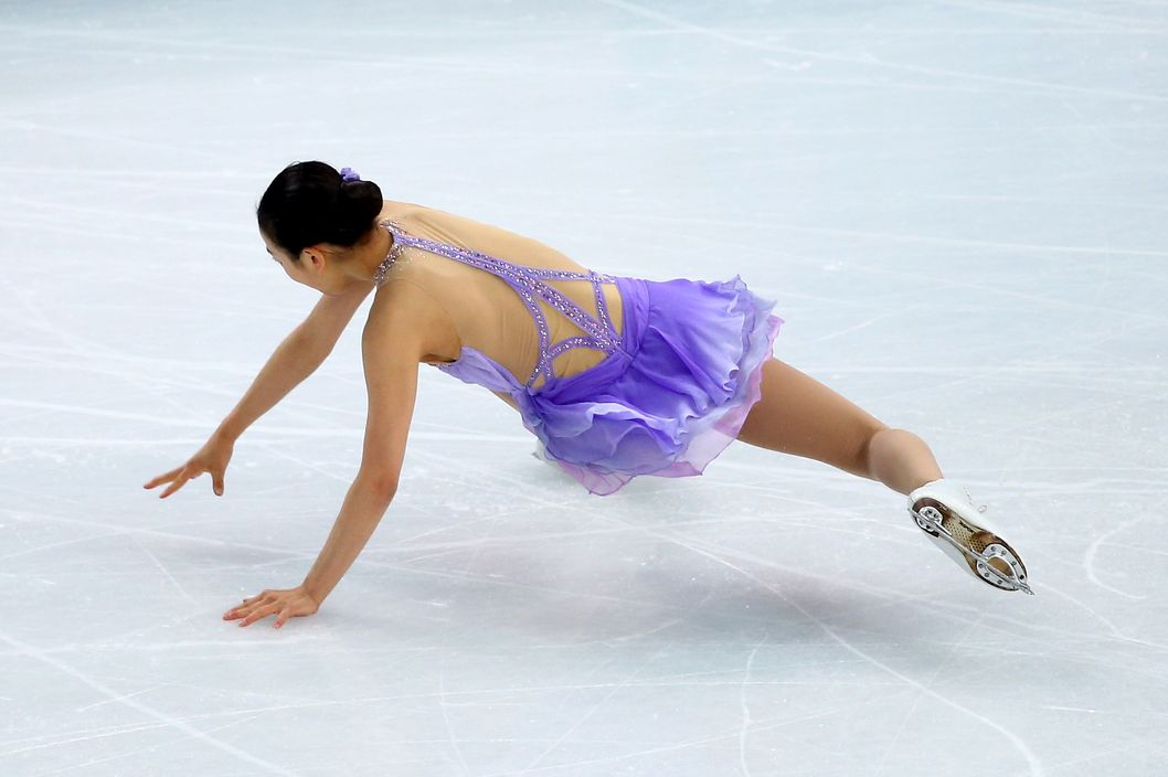 SOCHI, RUSSIA - FEBRUARY 19:  Mao Asada of Japan falls while competing in the Figure Skating Ladies' Short Program on day 12 of the Sochi 2014 Winter Olympics at Iceberg Skating Palace on February 19, 2014 in Sochi, Russia.  (Photo by Ryan Pierse/Getty Images)