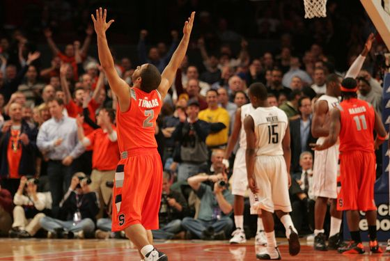 NEW YORK - MARCH 12: Justin Thomas #2 of the Syracuse Orange celebrates late in the sixth overtime against the Connecticut Huskies during the quarterfinal round of the Big East Tournament at Madison Square Garden on March 12, 2009 in New York City.  (Photo by Michael Heiman/Getty Images)