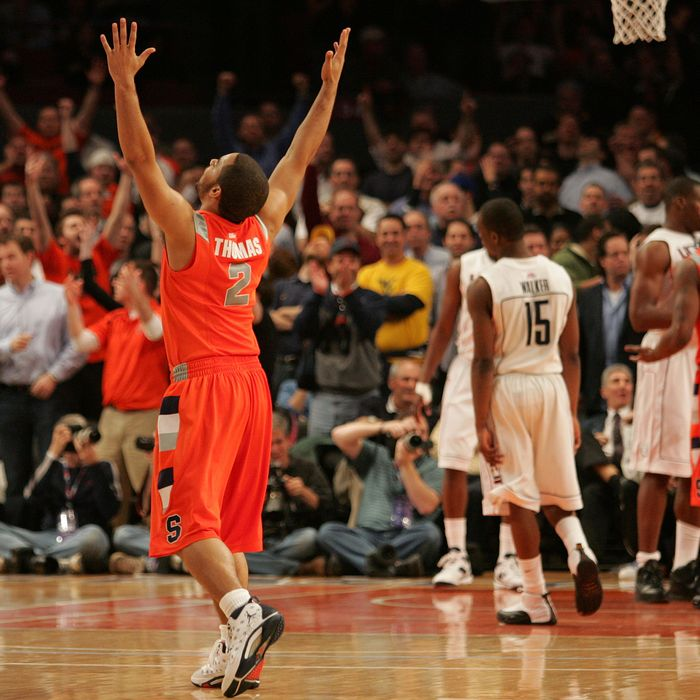 Justin Thomas #2 of the Syracuse Orange celebrates late in the sixth overtime against the Connecticut Huskies during the quarterfinal round of the Big East Tournament at Madison Square Garden on March 12, 2009 in New York City.