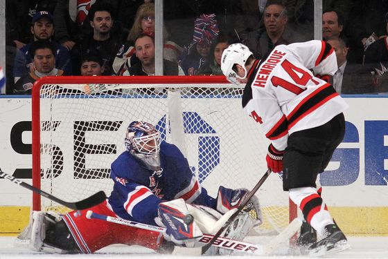 NEW YORK, NY - FEBRUARY 27: Henrik Lundqvist #30 of the New York Rangers makes the second period stop on Adam Henrique #14 of the New Jersey Devils  at Madison Square Garden on February 27, 2012 in New York City.  (Photo by Bruce Bennett/Getty Images)