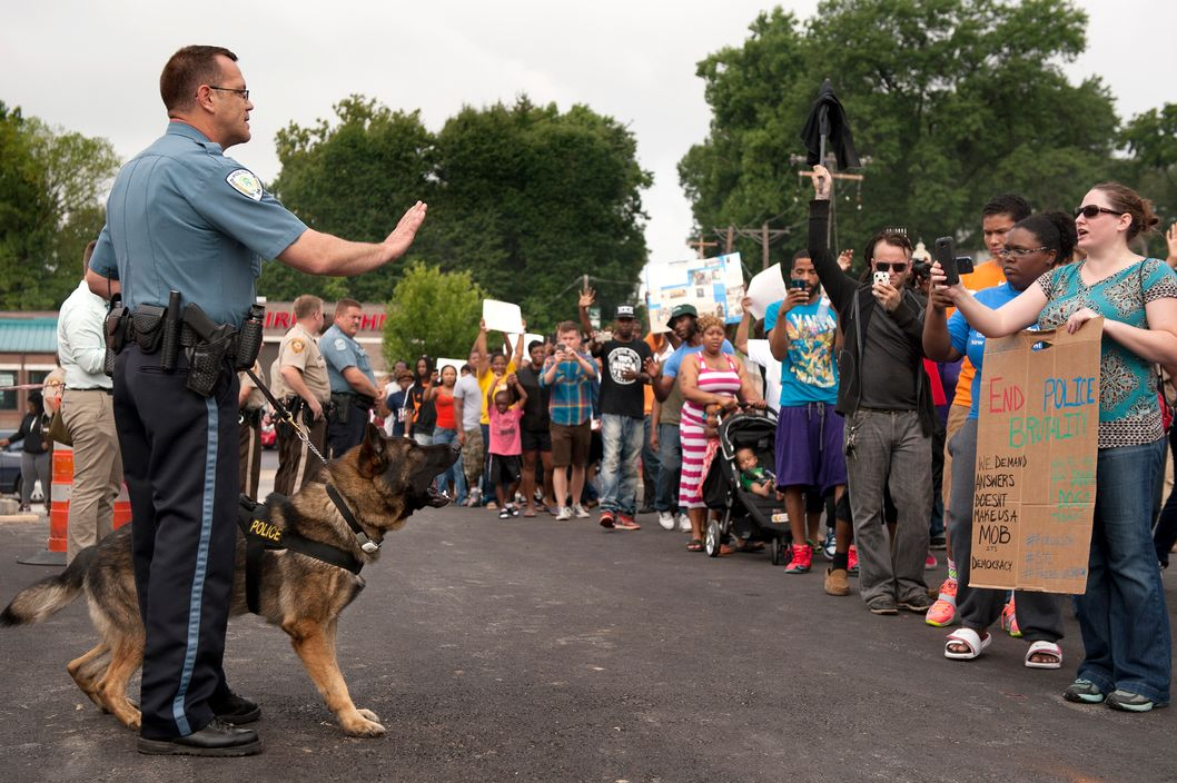 Protestors confront police during an impromptu rally, Sunday, Aug. 10, 2014 to protest the shooting of Michael Brown, 18, by police in Ferguson, Mo.  Saturday, Aug. 9, 2014. Brown died following a confrontation with police, according to St. Louis County Police Chief Jon Belmar, who spoke at a news conference Sunday. (AP Photo/Sid Hastings)