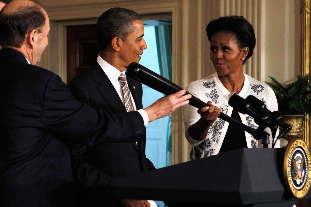 WASHINGTON, DC - JANUARY 17:  St. Louis Cardinals owner William DeWitt (L) hands a baseball bat to first lady Michelle Obama as U.S. President Barack Obama looks on during an event celebrating the 2011 Major League Baseball World Series champions in the East Room of the White House January 17, 2012 in Washington, DC. Noticably absent from the congratulatory event are the team's former 1st baseman Albert Pujols and former manager Tony La Russa. The Cardinal's visit to Washington will include a stop at Walter Reed Military Medical Center in Bethesda, Maryland, to visit with patients and their families.  (Photo by Chip Somodevilla/Getty Images)