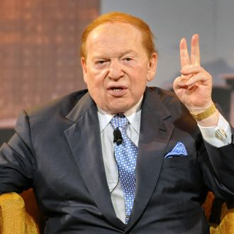 US gaming tycoon Sheldon Adelson gestures during a press conference at the Marina Bay Sands complex in Singapore on June 23, 2010.