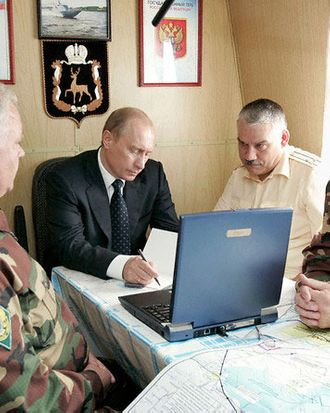 13 Jul 2005, Russia --- Russian President Vladimir Putin holds a meeting with senior officers from the Russian Border Guard service aboard a border patrol ship of the Federal Border Service, which he visited during his stay in Astrakhan.   Location: ASTRAKHAN, Russia. --- Image by ? Panov Alexei/ITAR-TASS/Corbis