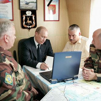 13 Jul 2005, Russia --- Russian President Vladimir Putin holds a meeting with senior officers from the Russian Border Guard service aboard a border patrol ship of the Federal Border Service, which he visited during his stay in Astrakhan. | Location: ASTRAKHAN, Russia. --- Image by ? Panov Alexei/ITAR-TASS/Corbis