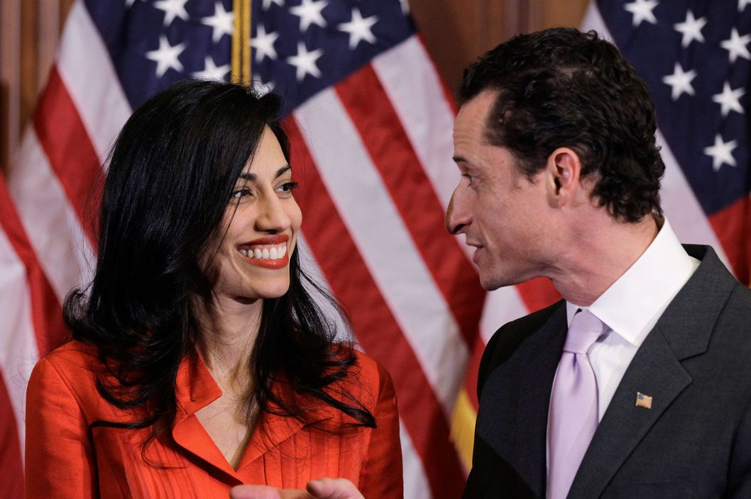 Rep. Anthony Weiner, D-N.Y., and his wife, Huma Abedin, aide to Secretary of State Hillary Rodham Clinton, are pictured after a ceremonial swearing in of the 112th Congress on Capitol Hill in Washington, Wednesday, Jan. 5, 2011..