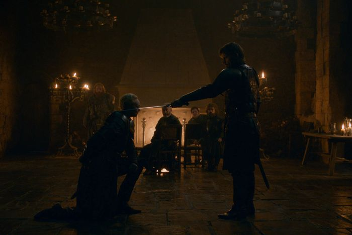Brienne of Tarth being knighted by Jaime Lannister on Game of Thrones.