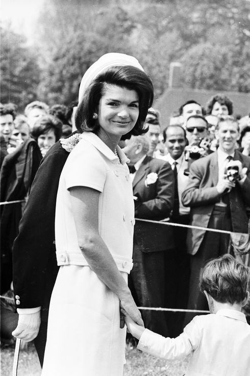 15th May 1965:  Jacqueline Kennedy (1929 - 1994) attends the inauguration of a memorial to her husband John F. Kennedy in Runnymede, Surrey, nearly eighteen months after his assassination. Holding her hand is her young son, John F. Kennedy Jr. (1960 - 1999).  (Photo by Michael Stroud/Express/Getty Images)