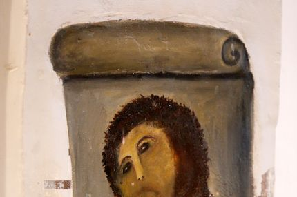 "View of the deteriorated version of ""Ecce Homo"" by 19th-century painter Elias Garcia Martinez, at the Borja Church in Zaragoza on August 28, 2012. An elderly woman's catastrophic attempt to ""restore"" a century-old oil painting of Christ in a Spanish church has provoked popular uproar, and amusement. Titled ""Ecce Homo"" (Behold the Man), the original was no masterpiece, painted in two hours in 1910 by a certain Elias Garcia Martinez directly on a column in the church at Borja, northeastern Spain. The well-intentioned but ham-fisted amateur artist, in her 80s, took it upon herself to fill in the patches and paint over the original work, which depicted Christ crowned with thorns, his sorrowful gaze lifted to heaven."