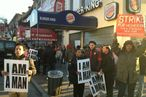 Workers strike outside a Burger King in Brooklyn early this morning.
