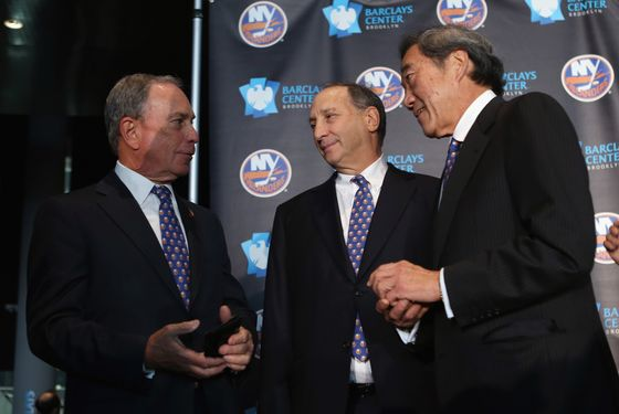 (L-R) Mayor Michael Bloomberg, owner Bruce Ratner of the Brooklyn Nets and New York Islanders owner Charles Wang announce the team's move to Brooklyn in 2015 at a press conference at the Barclays Center on October 24, 2012 in the Brooklyn borough of New York City.