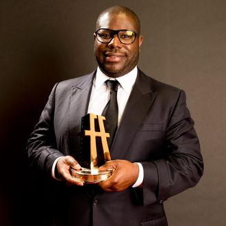 Director Steve McQueen poses with the Hollywood Breakout Director Award for '12 Years a Slave' in the portrait studio during the 17th annual Hollywood Film Awards at The Beverly Hilton Hotel on October 21, 2013 in Beverly Hills, California.