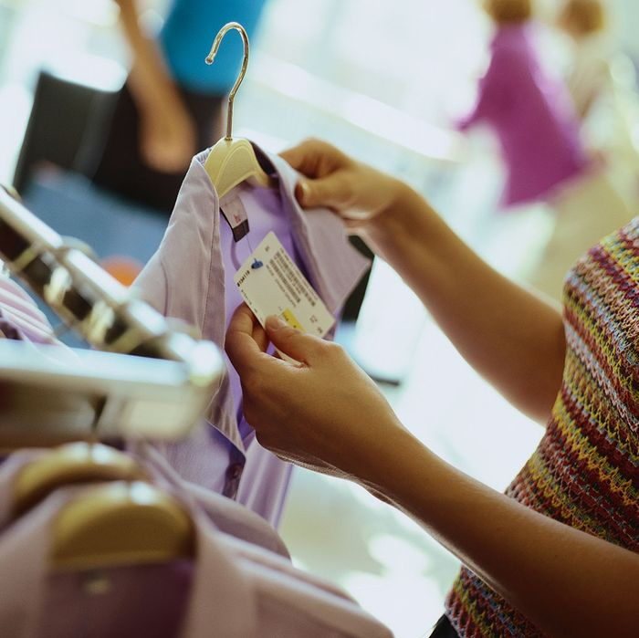 Shopper Looking at Price Tag