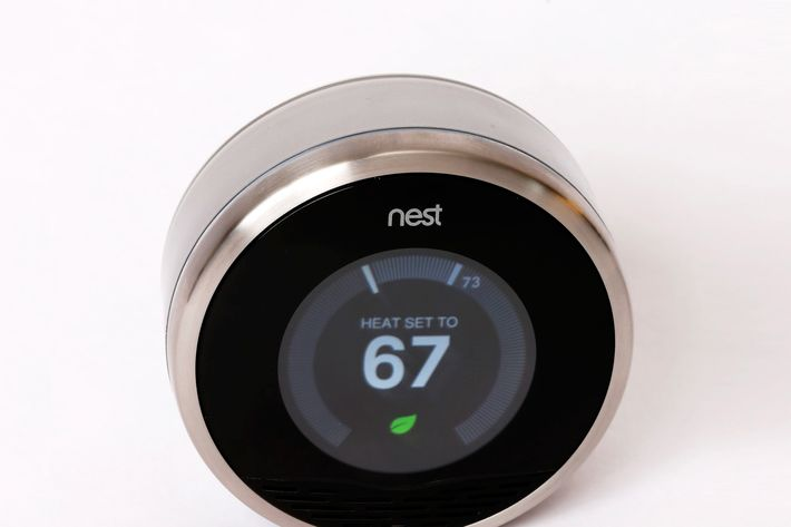 PROVO, UT - JANUARY 16: In this photo illustration, a Nest thermostat is seen on January 16, 2014 in Provo, Utah. Google bought Nest, a home automation company, for $3.2 billion taking Google further into the home ecosystem. (Photo Illustration by George Frey/Getty Images)