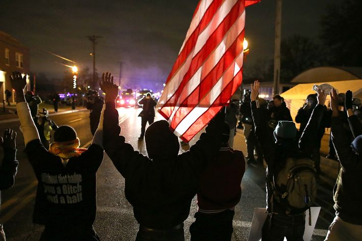 FERGUSON, MO - NOVEMBER 24:  Protestors stand with their hands up during a demonstration on November 24, 2014 in Ferguson, Missouri. A St. Louis County grand jury has decided to not indict Ferguson police Officer Darren Wilson in the shooting of Michael Brown that sparked riots in Ferguson, Missouri in August.  (Photo by Justin Sullivan/Getty Images)