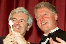 "Before the annual dinner of the Radio and Television Correspondents Association in Washington 14 March 1995, US President Bill Clinton (R) poses with House Speaker Newt Gingrich as President Clinton shows Gingrich a plastic utensil known as a ""spork."" In his remarks, Clinton spoofed himself on ways for the US government to save money, saying, ""No more false choices between right utensil and left utensil. This is not an ideological choice. This is a big, new idea-the spork."" (COLOR KEY: Yellow pattern in Gingrich's tie.)       AFP PHOTO (Photo credit should read PAUL J. RICHARDS/AFP/Getty Images)"